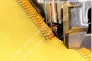 Jack JK-798D-4-83/323 4-х ниточный промышленный оверлок с встроенным сервоприводом и устройством закрепки цепочки