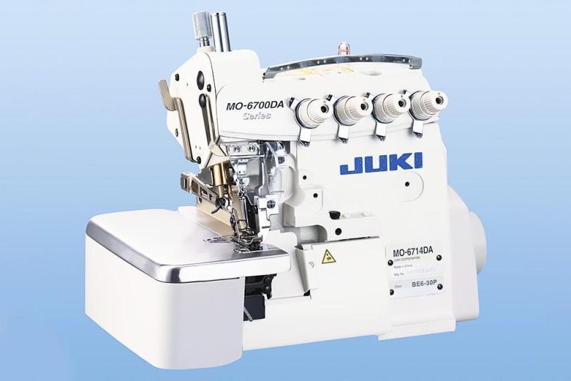 Промышленный 4-х ниточный высокоскоростной оверлок Juki MO-6714DA-BE6-44H/G39/Q141 с сухой головой и приспособлением для пришивания тасьмы